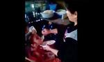 Hai bé gái bị phụ nữ đút cơm kiểu hành hạ