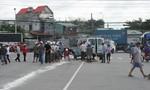 Tài xế container cán chết một phụ nữ trên đường