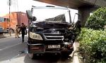 Tránh xe gặp tai nạn, ô tô và xe container 'dính chặt' trên quốc lộ
