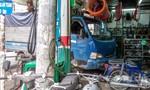 Xe tải tuột thắng lao vào tiệm sửa xe, 4 người thoát chết