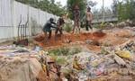 Chôn lấp trái phép 33 mét khối rác thải
