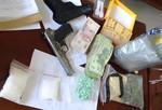 TP Biên Hòa: Đột kích nhà không số, thu giữ 1,1 kg hàng 'đá' và súng đạn