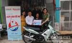 Tặng xe máy cho gia đình nghèo ở quận Bình Tân