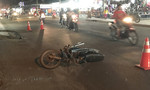 Xe tải bỏ chạy sau tai nạn với xe máy