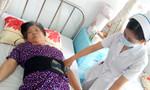 Cụ bà 70 tuổi liệt 2 chân đi lại được sau khi được bơm xi măng vào đốt sống lưng