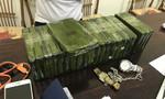 Bắt vụ mua bán 21 bánh heroin, 2 cảnh sát bị thương