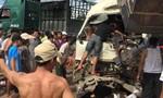 Xe khách và xe tải tông dính vào nhau, 10 người bị thương