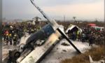 Máy bay chở 71 người bốc cháy khi hạ cánh
