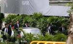 Dàn vệ sĩ chạy bộ tháp tùng xe nghi chở Kim Jong Un