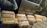 Phát hiện 100 bánh cocain trong container thép phế liệu