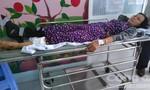 Một phụ nữ thoát chết khi bị xe khách cuốn vào gầm