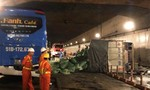 Xe tải tông xe khách lật rồi nhào trong hầm Thủ Thiêm
