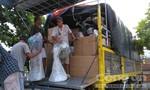 Xe tải mang theo biển số giả chở đầy hàng lậu về Sài Gòn tiêu thụ
