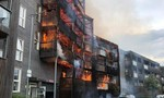 Clip 100 lính cứu hỏa chiến đấu với lửa bao trùm chung cư ở Anh