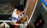 Clip người phụ nữ liều lĩnh nhảy khỏi thang máy đang di chuyển