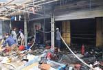 Cháy chợ Tó, hàng chục ki ốt bị thiêu rụi