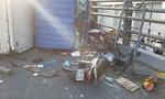 Xe tải tông 2 xe máy rồi lật trên cầu vượt Cây Gõ, 4 người trọng thương