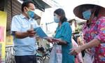 """Người dân đi chợ bằng """"tem phiếu"""" in mã QR đầu tiên ở Sài Gòn"""