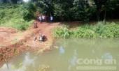 Phát hiện xác 3 cha con dưới hồ nước