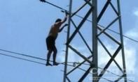 Giải cứu nam thanh niên leo cột điện cao thế