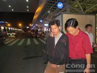 Hung thủ cười tươi khi bị di lý từ Hà Nội vào TP.HCM
