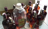 Đột kích lò sản xuất rượu Chivas 18 bằng nước màu kho cá