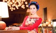 MC Thanh Mai duyên dáng diện áo dài cách tân giao lưu với Tổng thống Pháp