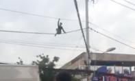 Nam thanh niên nghi ngáo đá đu dây điện ở Sài Gòn