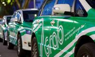 Dừng dịch vụ đi chung xe của Grab và Uber