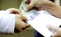Cán bộ thuế nhận hối lộ 100 triệu đồng