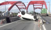 TP.HCM: Sáng tai nạn chết người, chiều ô tô 'phơi bụng' trên cầu Ông Lớn