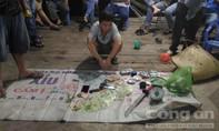 Hơn 100 cảnh sát phá sòng bạc 'khủng' ven sông