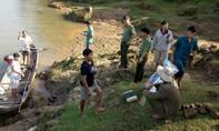 Trục vớt thi thể của cháu bé 3 tuổi mất tích dưới sông