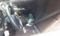 Ô tô đậu trong bãi giữ xe của siêu thị bị đập cửa khoắng sạch tài sản