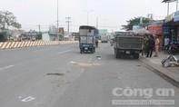 Xe tải tông xe máy chở hai người rồi bỏ chạy