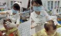 Bé gái bị khỉ nhà hàng xóm cạp lún sọ xuất viện trong vòng tay gia đình
