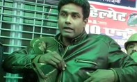 Cảnh sát thoát chết nhờ viên đạn trúng đồng xu trong túi áo