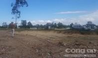 Chủ đầu tư phá cổng làng vào san ủi nghĩa trang