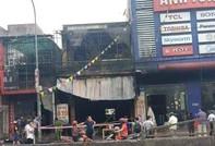Cháy cửa hàng thiết bị ôtô, 2 ông cháu tử vong