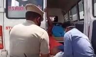 Clip cảnh sát Ấn Độ giả bệnh nhân nCoV răn đe người vi phạm
