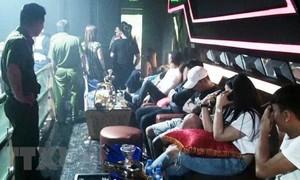 Gần 100 dân chơi quay cuồng trong quán bar Holiday Club