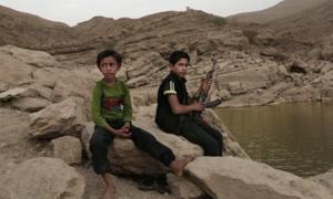 LHQ cảnh báo hơn 8500 trẻ em bị điều làm lính chiến đấu