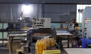 Đột kích xưởng làm giả nhãn hiệu nước tăng lực Number One quy mô lớn