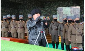 Ông Kim Jong Un vừa giám sát tập trận, vừa chỉ đạo phòng dịch nCoV