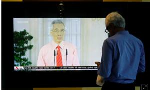 Singapore đóng cửa trường học, nơi làm việc chống dịch Covid-19