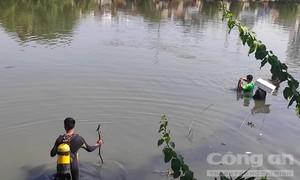 Rơi từ mũi sà lan xuống kênh ở Sài Gòn, một người mất tích