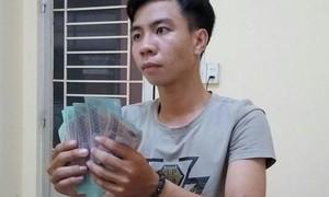 Bắt 4 đối tượng tàng trữ và lưu hành lượng lớn tiền giả
